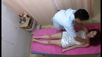 Meaty Asian Daniella Kovesas takes massage from behind on bed